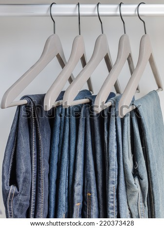 row of  jeans on hangers