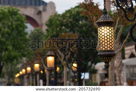 row of lanterns at evening