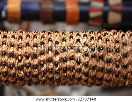 row of leather bracelet in front of a souvenir shop