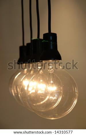 Row of light bulb with shallow DOF - stock photo