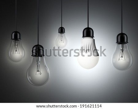 row of light bulbs and glowing LED bulb