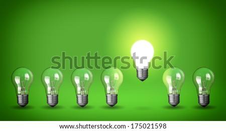 Row of light bulbs.Idea concept on green background. - stock photo