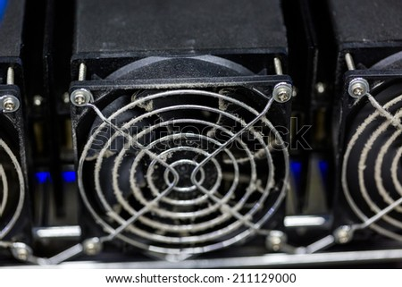 Row of litecoin miners set up on the wired shelfs. - stock photo