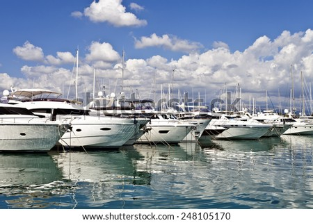 Row of luxury yachts mooring in a harbour - stock photo