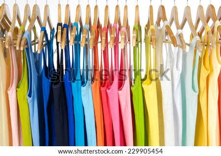 Row of many peignoir hanging on wooden hangers - stock photo