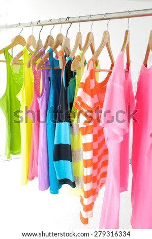 Row of many peignoir ,shirt hanging on wooden hangers - stock photo
