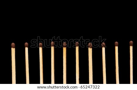 row of matches on black background