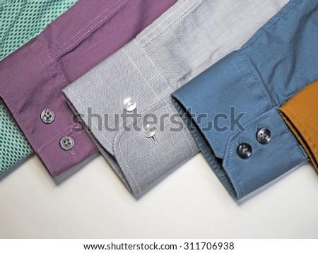 Row of men's shirt sleeves - stock photo