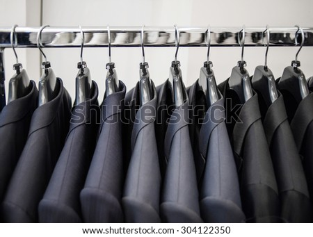 Row of men's suit jackets - stock photo