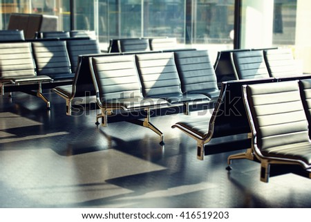 Row of metal chairs in hall waiting for departure