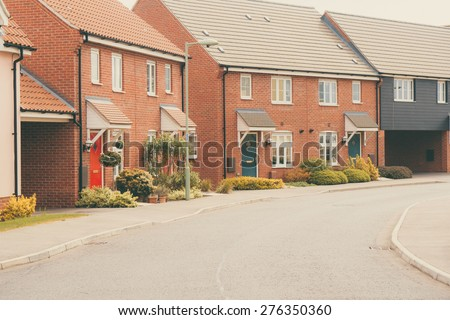 Row of Modern newly built housing development - stock photo