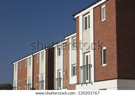 Row of modern 3 storey town houses in UK street