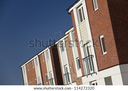 Row of modern 3 storey town houses in UK town - stock photo