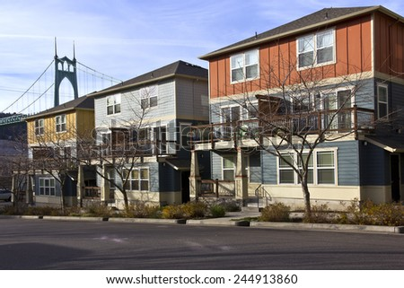Row of new duplexes homes overshadowing the St.John bridge Oregon. - stock photo