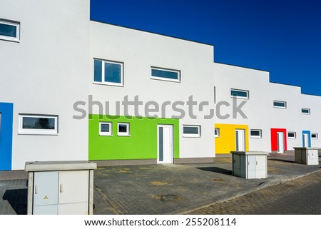 Row of new modern family houses ready to be moved in - stock photo