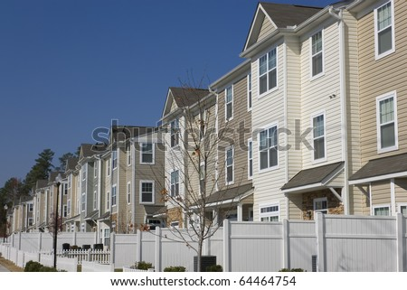 Row of newly build townhouses - stock photo
