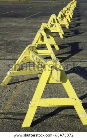 "Row of ""No Parking"" barriers across parking lot - stock photo"