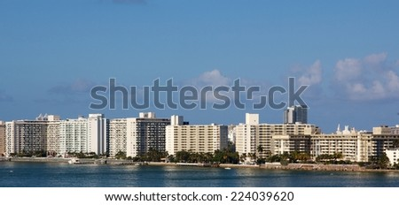 Row of nondescript apartment buildings by the water in Miami, FL, USA.