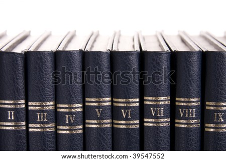 Row of old books with roman numbers - stock photo