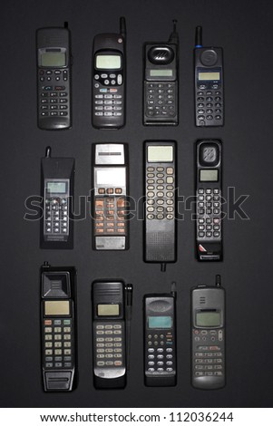 Row of old cell phones - stock photo