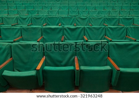 Row of old green seats in theater - stock photo