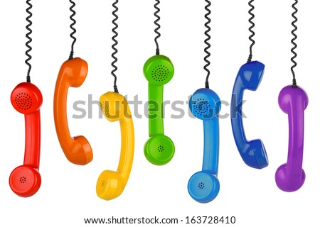 row of old handsets on white background - stock photo