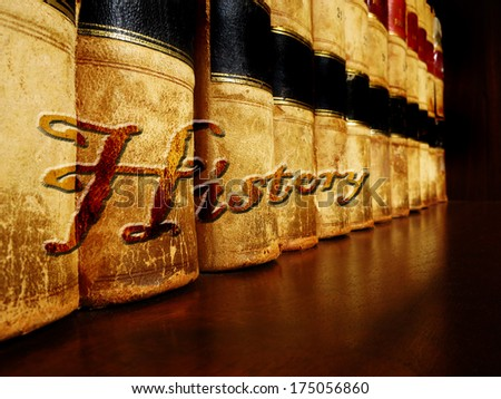Row of old leather books on a shelf with word History cover - stock photo