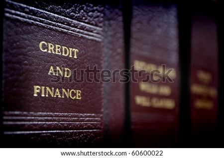 Row of old leather law books on a shelf - stock photo