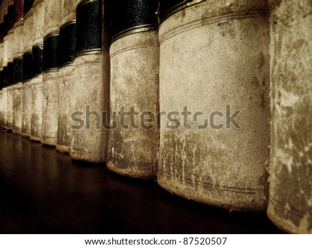 Row of old worn leather law books on shelf - stock photo