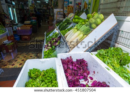 Row of organic Fresh Fruits and Vegetables at Little India City Market, Singapore - stock photo