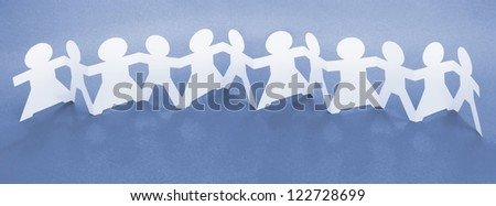 Row of Paper Chain Dolls Holding Hands on Blue Background