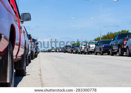 row of parked cars in parking lot