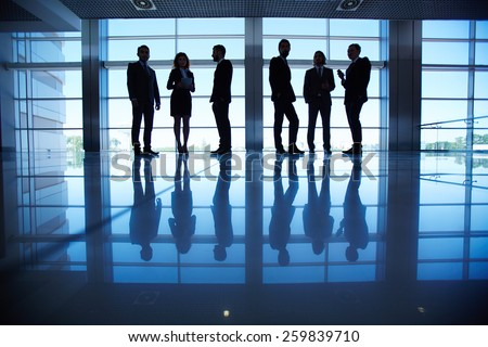 Row of people in formalwear in the dark - stock photo