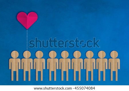 row of people shape paper cut and heart shape paper on blue background love concept - stock photo