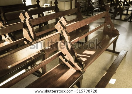 Row of pews in a Church, recall with nostalgia. - stock photo