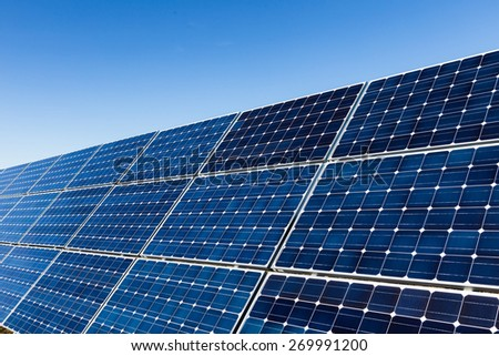 Row of photovoltaic solar panels and blue sky
