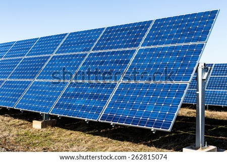 Row of photovoltaic solar panels and clear sky