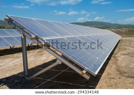Row of photovoltaic solar panels in fields of countryside