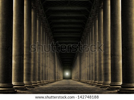 row of pillars at night with light at the end - stock photo