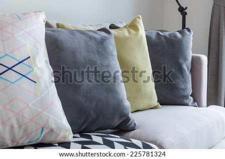 row of pillows on modern sofa in living room - stock photo