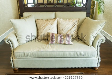 row of pillows on sofa in living room - stock photo