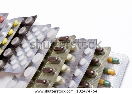 row of pills in blister packs - stock photo