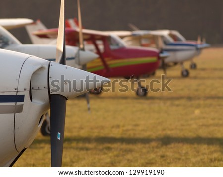 Row of planes' propellers at autumn sunset - stock photo