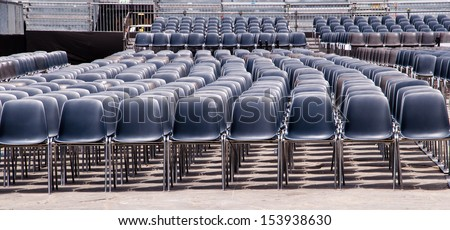 row of plastic churches in an open air arrangement - stock photo
