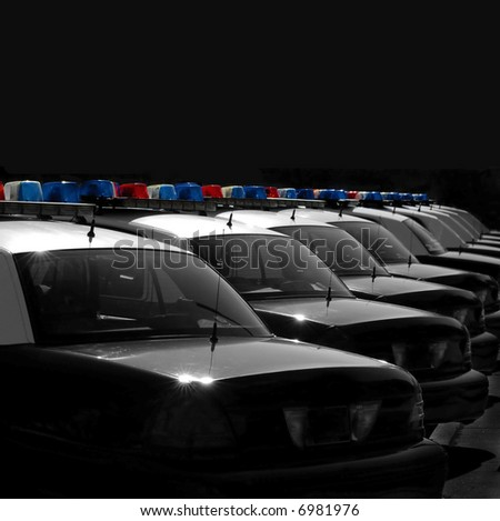 Row of Police Cars with Blue and Red Lights - stock photo