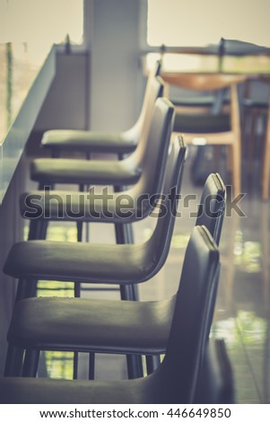 Row of pub style chairs - stock photo