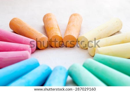 row of rainbow colored chalk - stock photo