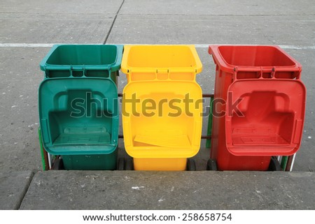 Row of recycle bins - stock photo