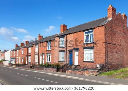 Row of red bricks terraced houses - stock photo