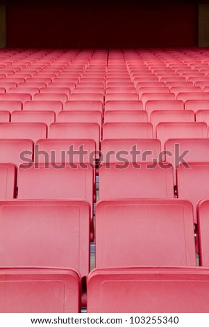 row of red seats in the big stadium